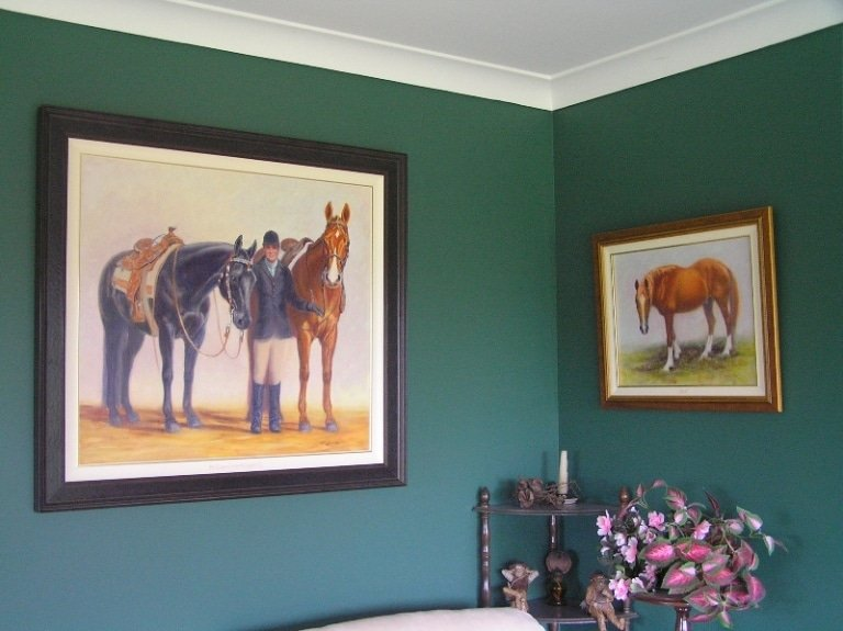 2 horse portraits on the wall