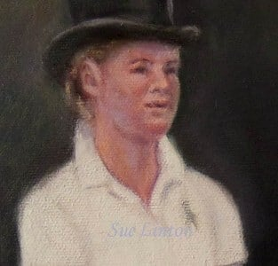 A closeup of a 59 x 59cms portraits rider's face