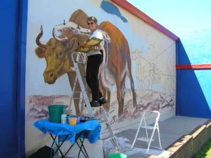 Sue painting the Bullocky Mural at Kurri