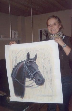 Gitte with her portrait of Piquett