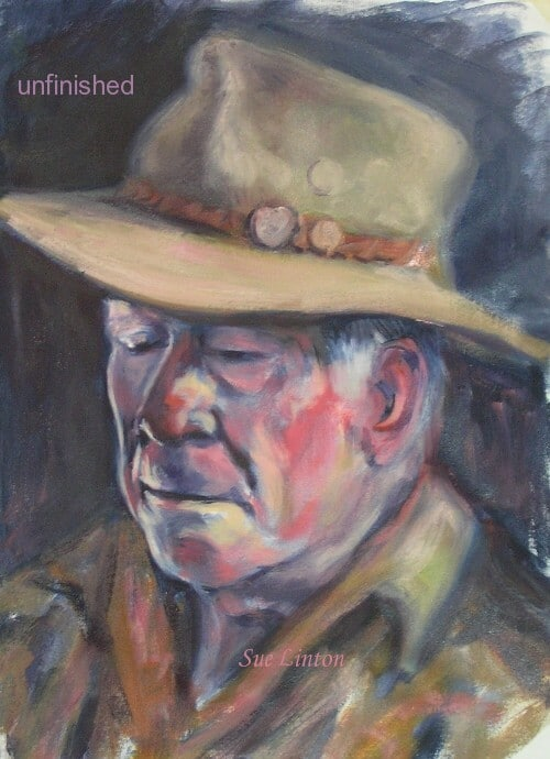 A portrait of a man in hat