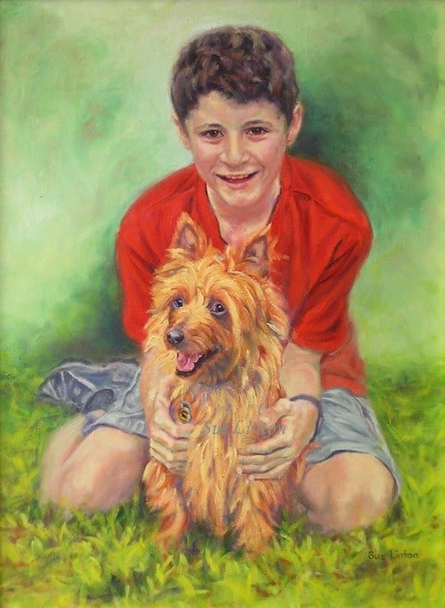 A portrait of a a young boy and his dog