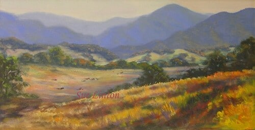 An australian landscape of a valley with ranges of mountains behind