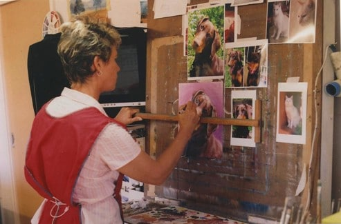 Sue painting a pet portrait in her studio