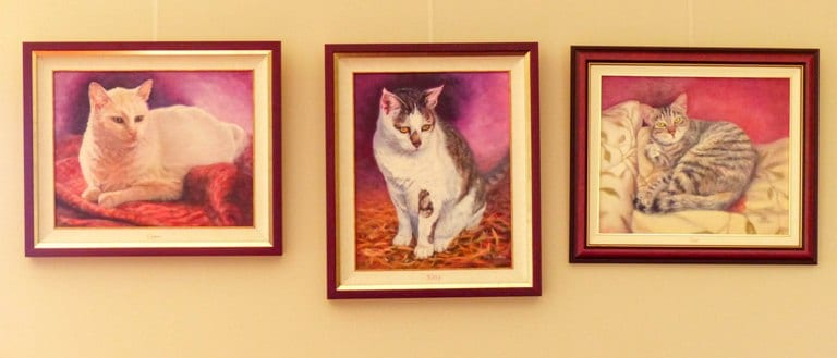 Casper's portrait on the wall with some of the other portraits