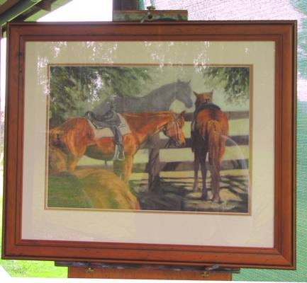 The framed portrait- sorry not the greatest photo due to glass reflections . The portrait is framed with  2 mats under glass with a tasteful wooden frame.