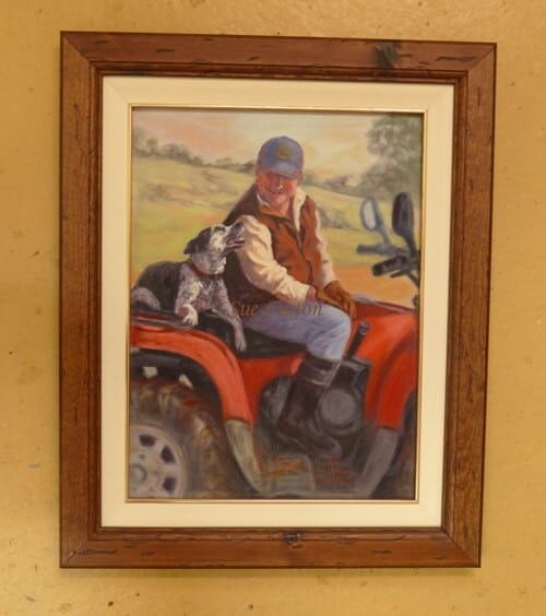 The painting is framed with a cream inner wooden slip with gold line and a distressed wood frame.