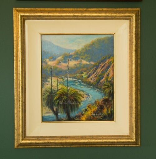 The painting has a cream wooden inner slip with gold line and a mottled gold frame.