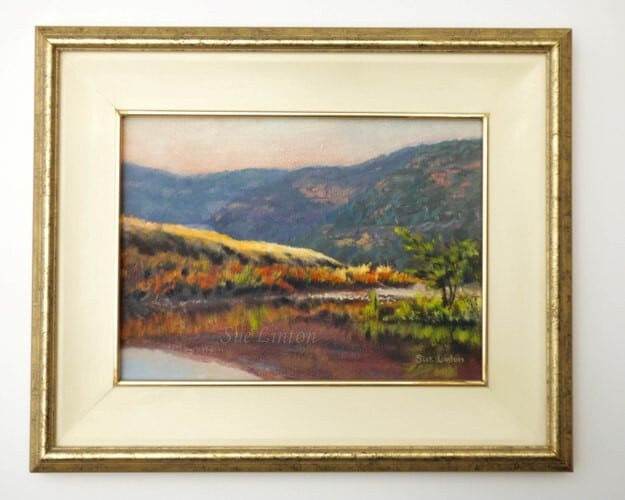 The framed landscape of the river and rocky hills