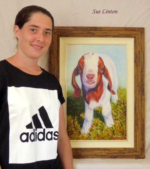 Caitlin with her pet portrait of her goat Wilson created from a photo #petportraits#custom pet portraits