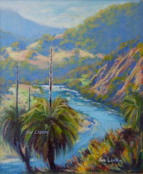 An Australian landscape of a river and grasstrees