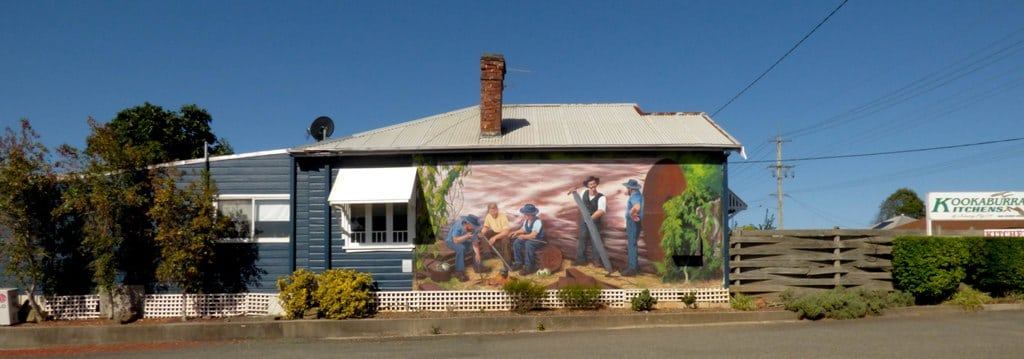 The mural on the side of Kookaburra kitchen's house.