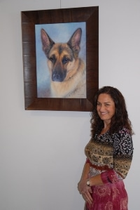 An Oil portrait of an Alsatian dog with it's happy owner