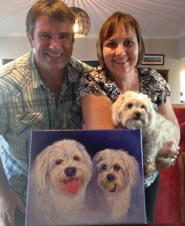 Happy neighbours with their portrait gift