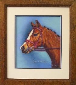 A framed pastel of a pony