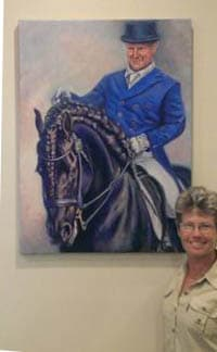 A large portrait of a dressage rider on his fresian horse