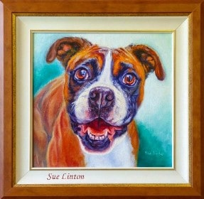 A framed oil of a dog