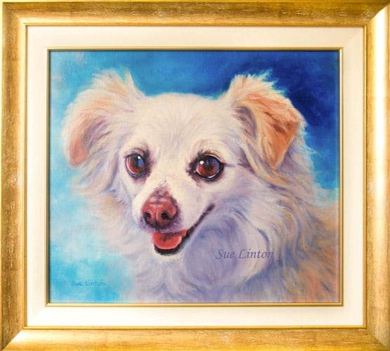 The custom framed portrait of a dog painted from a photo