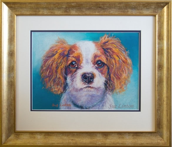 A framed pet portrait painted from a photo
