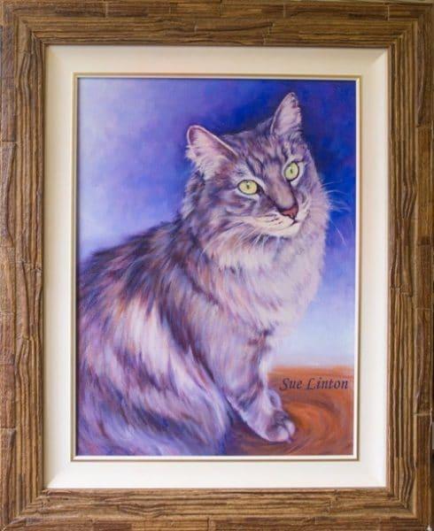 A custom framed pet portrait of a cat