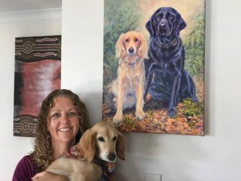 Ally loves her portrait of her 2 dogs