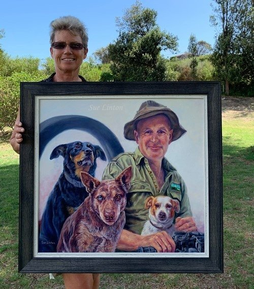 An oil portrait of a farmer and his working dogs