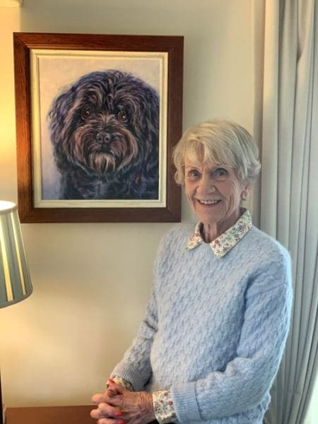 A happy customer with her memorial portrait