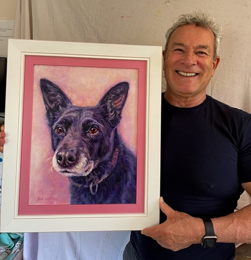 A happy customer with his portrait of his kelpie cross