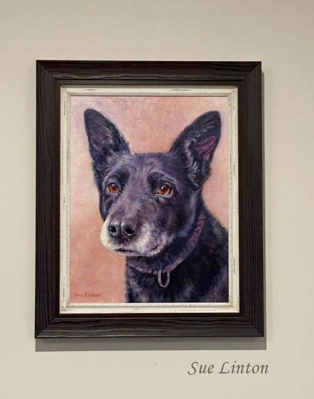 The Oil portrait of Missy framed and on the wall